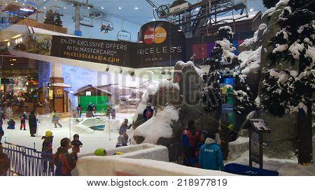 DUBAI, UNITED ARAB EMIRATES - MARCH 30th, 2014: Alpine ski in Dubai. Ski Dubai is an indoor ski resort with 22, 500 square meters of indoor ski area. It is a part of the Mall of the Emirates.