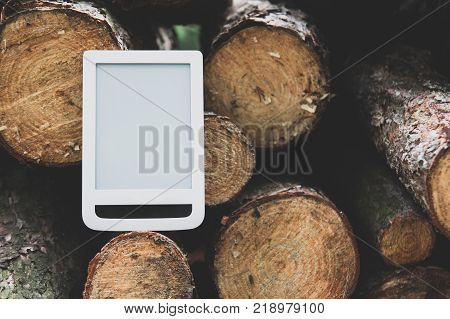 E-book on the background of felled trees save trees - read e-books concept