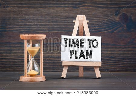 Time To Plan. Sandglass, hourglass or egg timer on wooden table showing the last second or last minute or time out