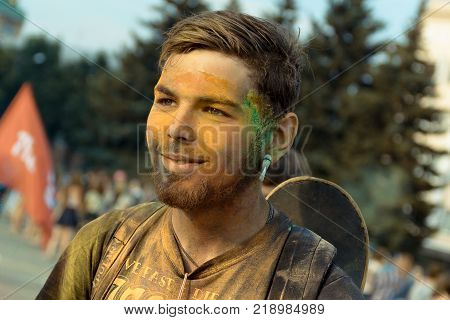 Yoshkar-Ola, Russia - Jule 16, 2016 Young participant during the festival of colors in the central square in Yoshkar-Ola, Russia