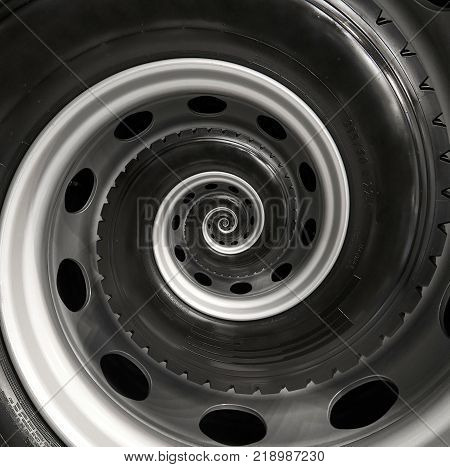 Car truck wheel abstract spiral fractal pattern background. Repetitive automobile automotive spiral background. Car wheel abstract pattern background. Truck wheel rim abstract spiral background