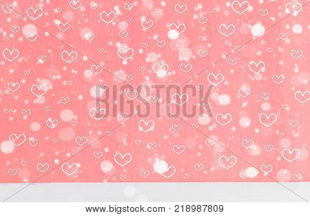 Heart shape and snowfall on sweet pink wood background with copy space. Lovely heart shape and snow raster pattern for Christmas or new year and love theme on Valentine's day concept. Pink heart shape with snow can apply for product display and background