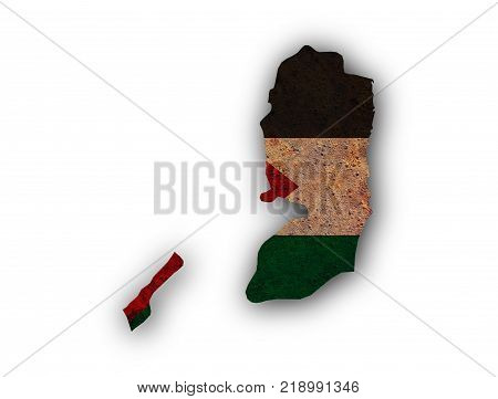 Colorful and crisp image of map and flag of Palestine on rusty metal