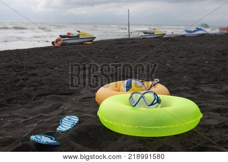 Ball swimming glasses sandal Water scooter and two Floating Ring on beach. In the summer vacation. Beach life