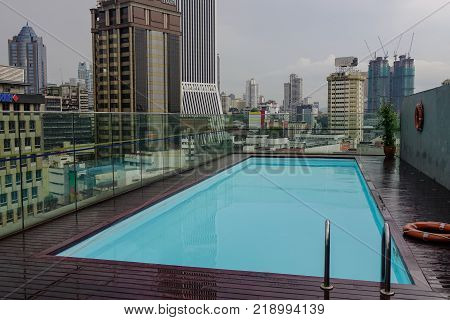 Kuala Lumpur Malaysia - Jan 2 2017. Roof top luxury swimming pool in Kuala Lumpur Malaysia. Kuala Lumpur is the sixth most visited city in the world with 8.9 million tourists per year.
