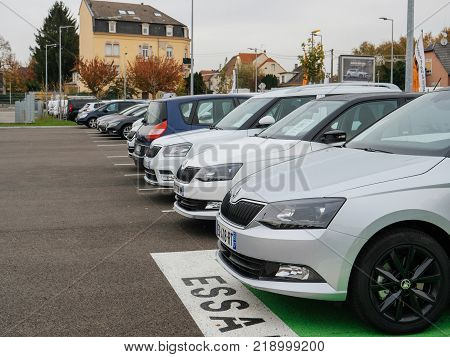 PARIS FRANCE - NOV 7 2017: Essai text translated as Test Drive cars with row of new Skoda Superb and Octavia cars made by Volkswagen at the car dealership garage