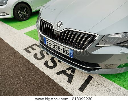 PARIS FRANCE - NOV 7 2017: Essai text translated as Test Drive cars with Skoda Superb luxury car made by Volkswagen at the car dealership garage