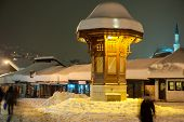 Sebilj during beautiful winter night in Old city of Sarajevo is a symbol of the town poster