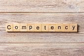 Competency word written on wood block. Competency text on table concept. poster