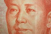 Macro detail of a Chinese one hundred rmb note bill showing the face portrait of Mao Zedong poster