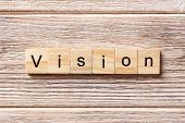 Vision word written on wood block. Vision text on table concept. poster