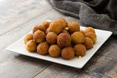 Gulab jamun on wooden table. Traditional indian dessert. poster