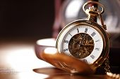 Vintage pocket watch and hour glass or sand timer, symbols of time with copy space poster