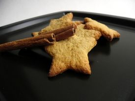 Tasty cookies on a black plate