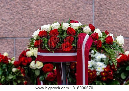 Flower Bouquet With Latvian Flag. Latvian Independence Day - Image