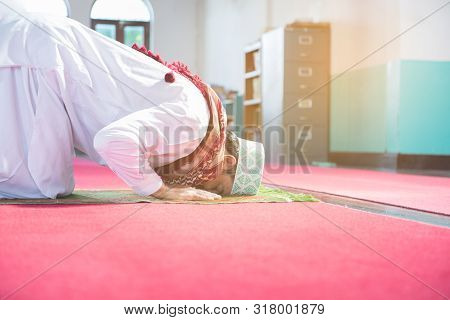 Young Muslim Arab Man Sit On Knee And Head Touch Floor In Mosque,ramadan Meditation Pray.