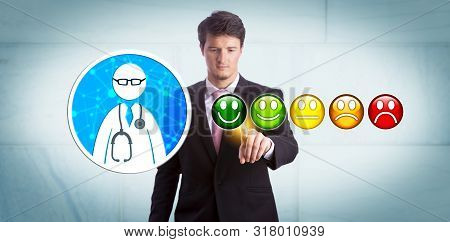 Young Smiling Business Manager Is Giving A Very Good Rating To A General Practitioner Via Online App