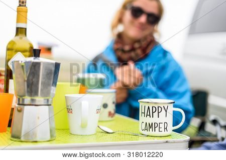 Woman Camping Travelling With Breakfast Mug And Happy Camper Text. Woman Drinking Coffee Or Tea From