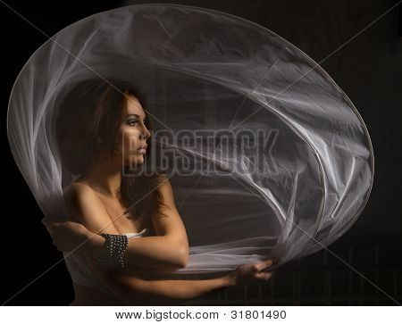 Portrait of sexy woman with white petticoat over darkness