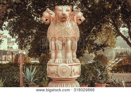 Lions On Sculptured National Emblem Of India. Copy Of The Ansient Ashoka Pillar Of Sarnath.