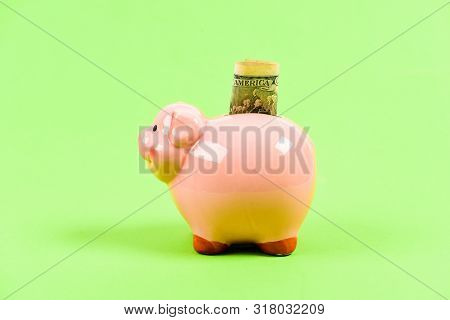 family budget. getting rich. income. saving money. success in finance and commerce. business startup. financial position. piggy bank with golden coin stack. Moneybox. sponsorship. poster