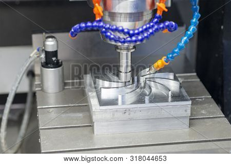 The Cnc Milling Machine Cutting The Aluminium Parts With Solid Ball Endmill Tools. The Mould And Die