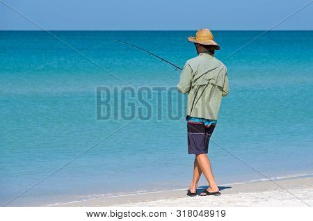 Unidentified Local Young Man At Holmes Beach On Anna Maria Island Florida In The Shallow Water Of Th