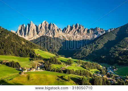 Santa Maddalena Church And Geisler (odle) Dolomites Mountain Peaks During Sunset - Val Di Funes, Sou