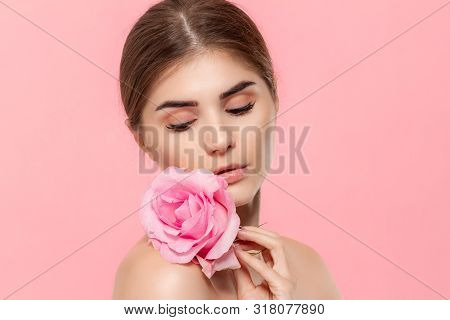Close-up Portrait Of A Beautiful Young Girl Holding Pink Rose Flower Close To Face Isolated Over Pin