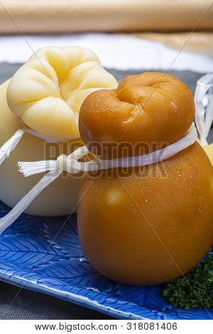 Italian Provolone Caciocavallo Aged And Smoked Cheeses In Teardrop Form Served On Blue Plate Close U