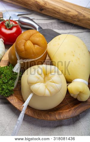 Italian Provolone Or Provola Caciocavallo Hard And Smoked Cheeses In Teardrop Form Served On Olive T