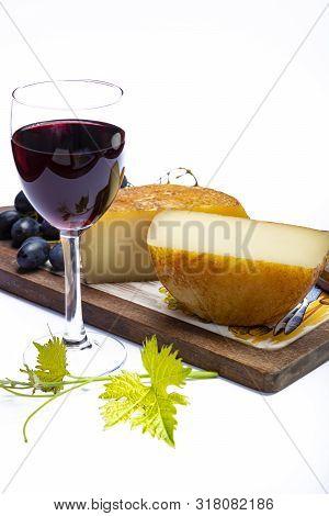 Hard Italian Pecorino Sheep Cheese And Glass With Italian Red Wine