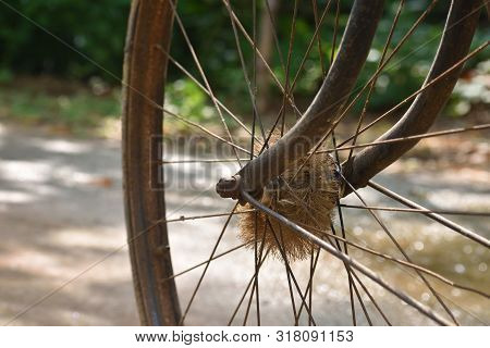 Old Wheel Of Bicycle Spoke Detail Isolated Background. Used Motion Blurr For Simulated Motion Wheel.