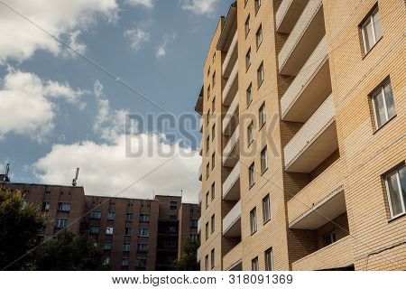 poster of Modern apartment buildings on a sunny day with a blue sky. Facade of a modern apartment building. residential building modern apartment condominium architecture
