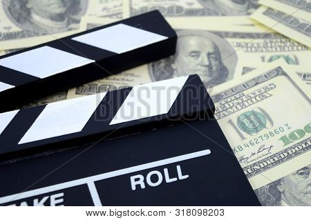A Conceptual Image Focused On The Movie Industry And The Money It Can Produce Using A Clapboard And