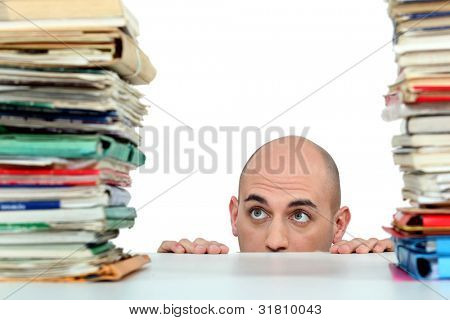 Man staring nervously at piles of folders poster