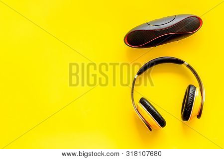 Wireless Speaker And Headphones As Music Gadgets On Yellow Background Top View Mockup