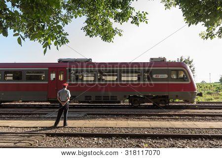Alibunar, Serbia - June 30, 2019: Regional Dmu Train Passing By Alibunar Train Station Being Watched