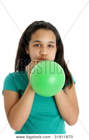 Teen Girl Blowing Up a Balloon in Studio