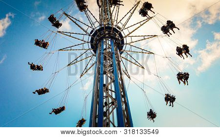 Swings In Amusement Park For Fun And Excitement
