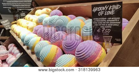 Bath Bombs On Display In A Shop In Wooden Crate With Ylang Ylang.  Lots Of Beautiful And Bright Colo