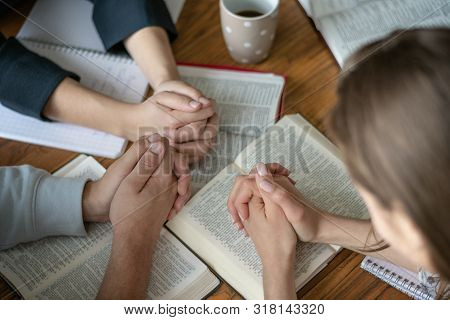 Christian Worship And Praise. Happy Friends Praying And Reading The Bible Together.