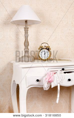 Bedroom table with a drawer and sexy lace lingerie