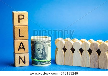 Wooden Blocks With The Word Plan And A Business Team Standing Next To Money. Strategy Planning. Mana