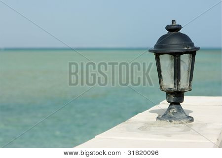 Lamp and sea on background