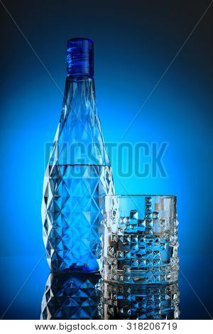 Fresh And Clean Drinking Water - Glass And Bottle On Blue Background