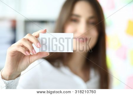 Focus On Tender Hand Of Smiling Businesswoman Showing Special Blank Business Card To Friendly Collea