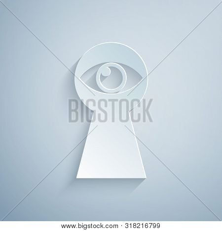 Paper Cut Keyhole With Eye Icon Isolated On Grey Background. The Eye Looks Into The Keyhole. Keyhole