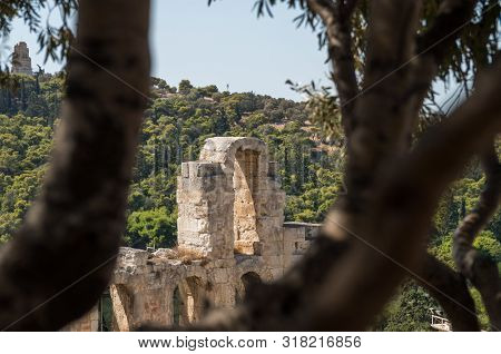 Close Up Of Theater Of Acropolis Of Athens View Trough The Vegetation And Trees