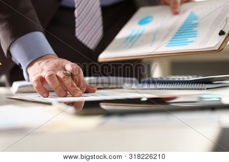 Advisor Verify Economic Profit Accounting Income. Male Financial Consultant Holding Pen Checking Bus